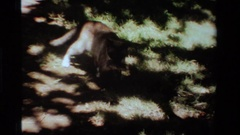 1984: siamese cat with a rodent in it's mouth crossing a brick patio CALIFORNIA Stock Footage