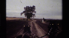 1984: tourists ride a horse drawn farm wagon on a country lane during harvest Stock Footage