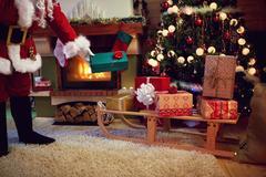 Santa Claus on xmas deliver presents for children . Stock Photos
