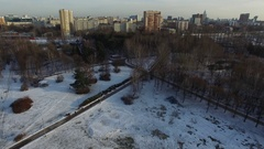 Moscow circle railway. Snowy park near the river in the winter megapolis Stock Footage