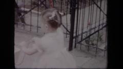 1958: a little girl pushing a little stroller NEW YORK Stock Footage
