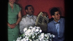 1959: a man reading the newspaper sitting with his family NEW YORK Stock Footage