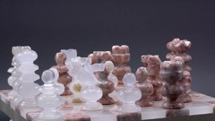Marble Stone Chess Set Game Isolated on Black Spinning, 4K Stock Footage
