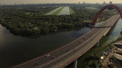 Highway road traffic on a bridge in megapolis. Aerial shoot Stock Footage