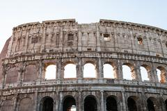 Wall of ancient roman amphitheater Colosseum Stock Photos