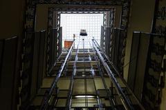 Lift shaft in old multi-storey building Kuvituskuvat