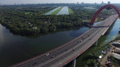 Highway road traffic on a bridge in megapolis. Aerial shoot. Stock Footage