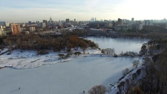 Snowy park near the river in the winter megapolis Stock Footage