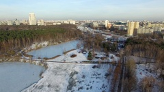 Moscow circle railway. Snowy park near the river in the megapolis Stock Footage