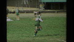 1984: a young girl in a green soccer uniform runs across the field CALIFORNIA Stock Footage