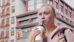 Young tourist drink bubble tea in Chinatown New York, USA Stock Footage