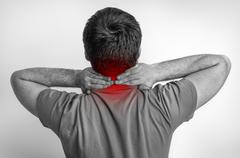 Man with muscle injury having pain in his neck  Stock Photos
