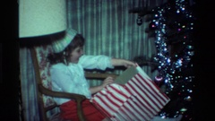 1984: happy pre-teen girl in a party hat is very excited opening her presents Stock Footage