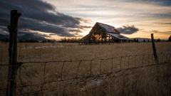 Time lapse of old barn at sunset Stock Footage