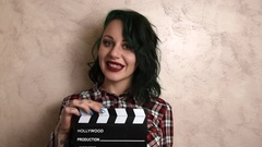 Woman and movie clapper board Stock Footage