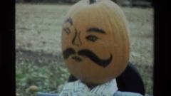1984: a scarecrow with a pumpkin head CALIFORNIA Stock Footage