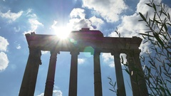 Rome day time blue sky sun light roman forum temple of saturn panorama 4k  italy Stock Footage
