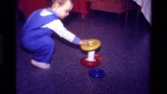 1979: a child plays on the floor with an educational toy and is very happy Arkistovideo