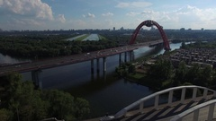 Cars are driving on a bridge over the river Stock Footage