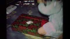 1981: person standing in a room with a toy in her hand CALIFORNIA Stock Footage