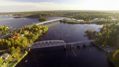 Overfly aerial shot of the bridges over lake Saimaa in autumn morning Stock Footage