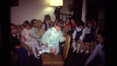 1981: children at a party play party games in a living room CALIFORNIA Stock Footage