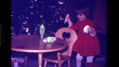 1979: a little girl excited for her new tea set CALIFORNIA Stock Footage