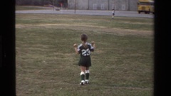 1981: a little kid is jumping up and down in the grass CALIFORNIA Stock Footage