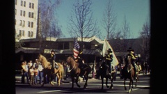 1981: uniformed officers march on foot and on horseback before onlookers Stock Footage