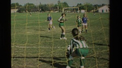 1984: a group of girls playing face to face on a hard-fought soccer match Stock Footage