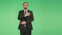 Body language. a man in a business suit on a green background Stock Footage