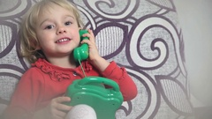Little girl on the phone Stock Footage