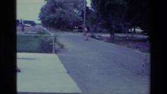 1976: female skateboarding down the street ALISO VIEJO CALIFORNIA Stock Footage