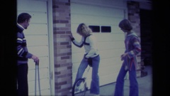 1977: trying to ride a unicycle ALISO VIEJO CALIFORNIA Stock Footage