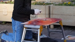 Street art - young guy painter artist draws a picture using aerography spray Stock Footage