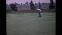 1976: girl playing golf trying to make a putt LAGUNA HILLS CALIFORNIA Stock Footage