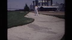 1976: a man getting ready to aim for golf LAGUNA HILLS CALIFORNIA Stock Footage