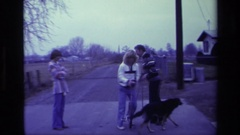 1976: a woman with a dog and a unicycle in a driveway ALISO VIEJO CALIFORNIA Stock Footage