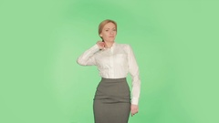 Body language. Beautiful blonde girl in a white blouse on a green background. Stock Footage