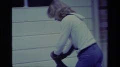 1976: girl rides unicycle in front of house ALISO VIEJO CALIFORNIA Stock Footage