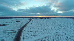 Aerial view of cars moving on winter road. Stock Footage