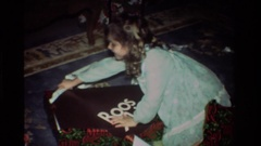 1981: the baby eagerly to open and see her gift in home CALIFORNIA Stock Footage