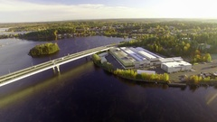 Approaching aerial shot of an industrial hall by a lake in Finland Stock Footage