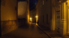 Silhouettes of a family walking on old town street of Prague at night. 4K Stock Footage