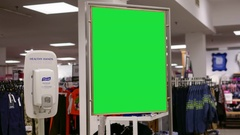 Green billboard for your ad beside Sears store entrance with 4k resolution Stock Footage