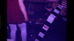 1979: a girl in red dress is looking out for some plaything CALIFORNIA Stock Footage