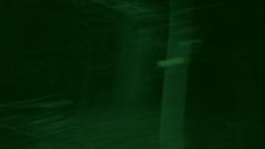 Hostage of terrorists running in night woods Arkistovideo