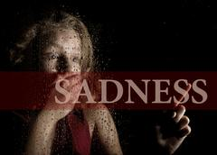 Sadness written on virtual screen. hand of frightened young girl melancholy and Kuvituskuvat