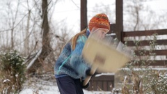 The child cleans shovel the snow covered track. Stock Footage