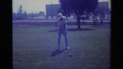 1977: a man in white hat is busy playing hockey game in playground LAGUNA BEACH Stock Footage